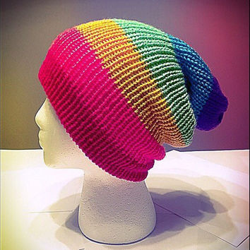 Slouchy, rainbow-inspired knitted beanie. Vibrant neon colors.