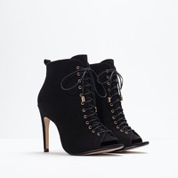 Peep-toe high heel leather bootie