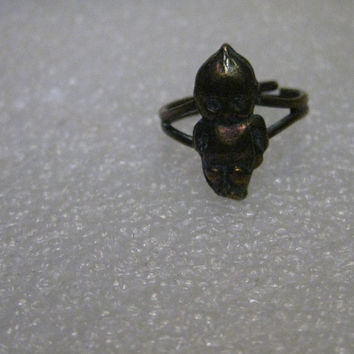 "Vintage Mid-Century Kewpie Doll Ring, Adjustable from size 5 to 8, Brass with Antique Wash, 3/4"" tall."