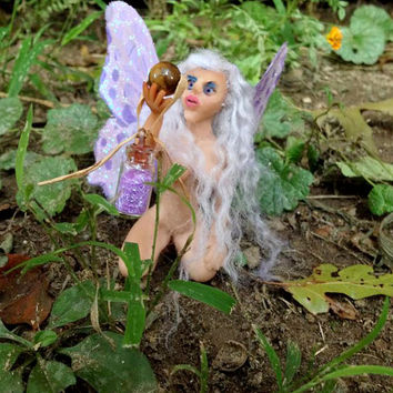 Fairy figurine holding tiger-eye and fairy dust polymer clay art doll