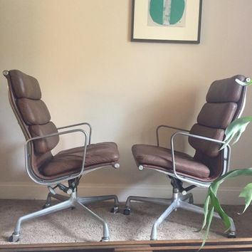 Herman Miller Eames soft pad executive chairs.