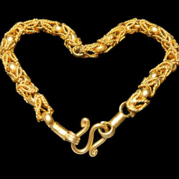 Gold link bracelet, gold links combine with twisted rope links for an intricate look