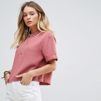 Tommy Hilfiger Denim Cropped Polo T-shirt with Zip at asos.com