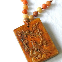 Rubbed Nephrite Jade Phoenix Symbol Pendant on Knotted Bead Necklace
