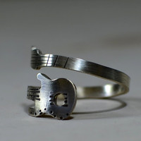 Sterling silver guitar wrap ring for a twisted musician