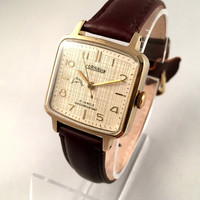"Vintage Square Men's watch called ""CORNAVIN"" ( POLJOT ). 21J movement. Gold plated case, brand new high quality leather band."