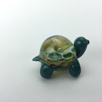 Teal glass turtle scupture with honeycomb shell