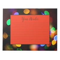 Multicolored Christmas lights. Lined stationery. Notepad
