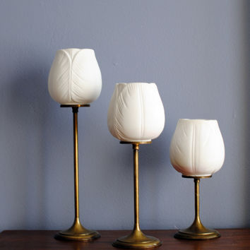 Vintage brass and white ceramic tulip votive candle holders set of 3. Decorative stemmed tulips. Mantle or shelf decor.