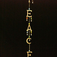 Peace. Brass metal and glass beaded  Wind chime. Long, lightweight. Home decorations.