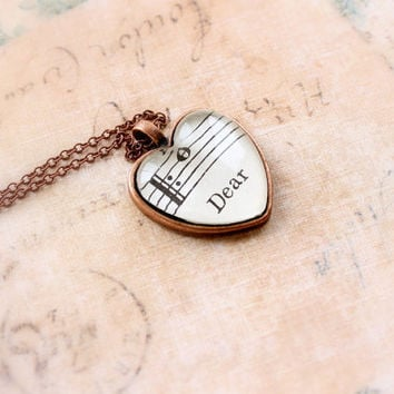 Heart pendant made with vintage sheet music.  Sweet gift for girlfriend, fiancee, wife for valentine's day.  Gift wrapped and ready to ship