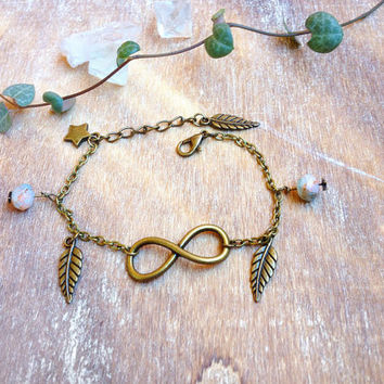 Infinity Bracelet. Feather bracelet. Eternity Bracelet. Adjustable feathers bracelet with earthy Czech glass beads star. Infinity jewelry
