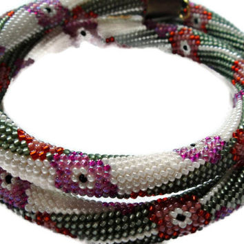 Bead crochet rope necklace with flowers in beige, green, red and lilac