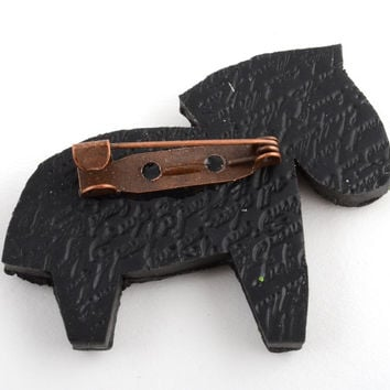 Handmade small beautiful black brooch made of polymer clay in shape of horse