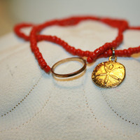 Sandollar bracelet. Sandollar charm. Gold plated sandollar and ring.  Summer bracelet. Thin bead bracelet. Red bracelet.