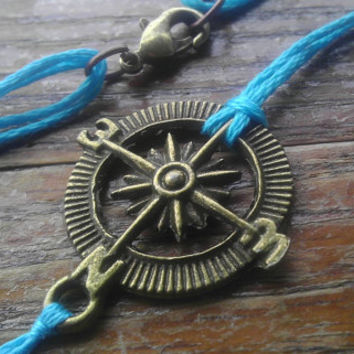 Compass bracelet with clasp