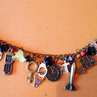 Bronze orange is the new black charm bracelet.