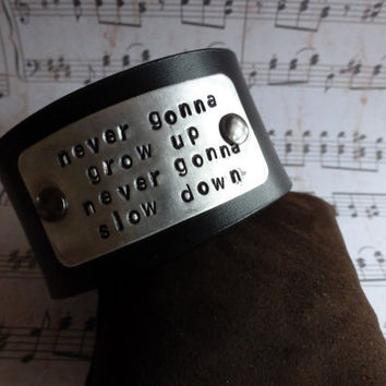 "Country Phrase Stamped on a  Leather Cuff Bracelet - ""Never Gonna Grow Up, Never Gonna Slow Down"""