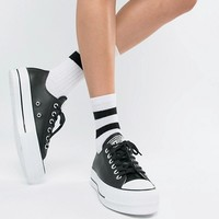 Converse Chuck Taylor All Star leather platform low trainers in black at asos.com