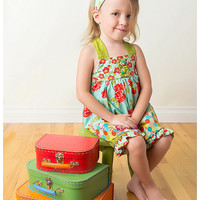 Gracies Garden Halter Top with Ruffle Capris with FREE matching headband.  With flowers and bow in whimsy red, blue, green, and yellow.