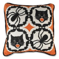 This spooky-home-decor felt appliqué pillow has a kaleidoscope looking pattern that has big spiders and classic looking, meowing black cats in each quadrant. The filigree borders around each of the cats and spiders are actually bats that surround the image