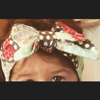 Spotted floral grey, teal, and coral colored bow tied headband (shown in toddler size)