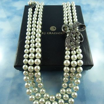 Signed Graziano Triple Strand Faux Pearl Statement Necklace With Large Ornate Pave Crystal Bow