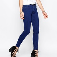Just Female Mid Rise Storm Skinny Jeans in Pure Blue at asos.com