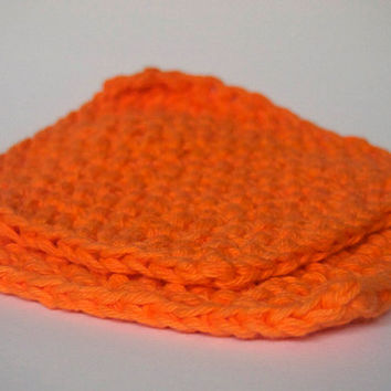 hand knit plushy small washcloth in bright orange