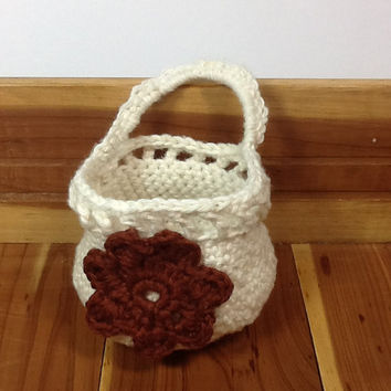 Doorknob basket, crocheted from cotton/linen yarn with flower embellishment, hanging basket for organizing storage in bath or nursery