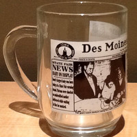 Vintage collectible souvenir glass coffee cup commemorating the Des Moines Tribune newspaper. Has a copy of the front page of the paper from