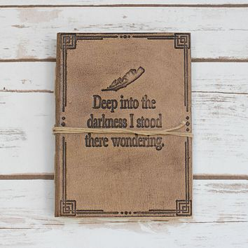 """Deep Into The Darkness"" Quote Embossed Tan Leather Journal"