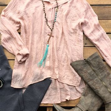 Our New In Town Top would be perfect for that transition into fall! It's a long sleeve button down top with collar. Linen like material and the sleeves could be worn rolled up or down. High low style and made to be loose fitted.