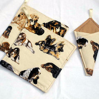 Potholders and Scissor Holder dogs on them in tan colors