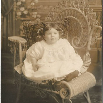 Beautiful Baby in Sienna Tones Of a Little Girl Sitting in a Garden Chair Vintage Real Photograph Postcard Antique