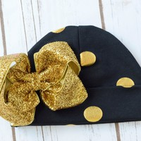 Baby girls hospital hats beanie gold dot hat is adorned with a 4 inch gold glitter bow. Bring your newborn home in style. Your FInal Touch Hair Accessories