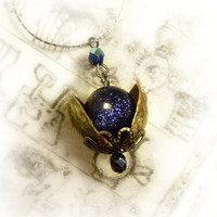 Universe in a nutshell pendant by UraniaArt on Etsy