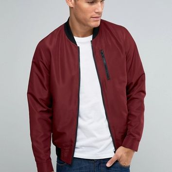 ASOS Bomber Jacket With Zip Chest Pocket In Burgundy at asos.com