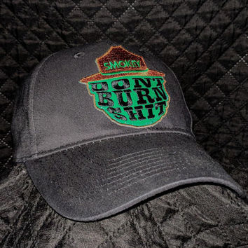 Black and green Smokey the bear hat