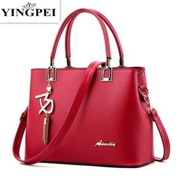 Women Patent Leather Smart Hand Bag With Metal Tassel Bag Charm