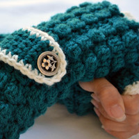 Teal and white crochet arm warmers, fingerless gloves with wrist strap and buttons in textured popcorn stitch
