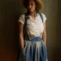 Gathered pinafore skirt with wooden buttons and hidden pockets. Super soft blue plaid cotton chambray. made to measure
