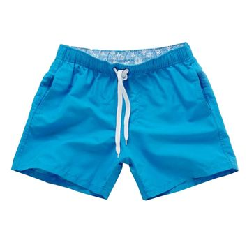 Quick Drying Beach Leisure Sports Shorts with Pocket Solid Colors Swim Trunks for Men