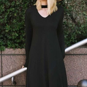 Solid black rayon spandex shift dress with front and back opening & pocket