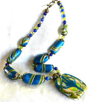 Natasha Style Pendant on Blue, Brass Necklace Signed by Polly Ceramica