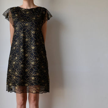 Black and gold lace tunic dress with fluttery cap sleeves. Fully lined. Size M