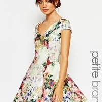 True Decadence Petite | True Decadence Petite Fit and Flare Full Skater Dress In All Over Floral at ASOS