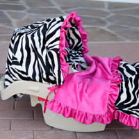 baby bella maya zoe the zebra car seat cover in made out of zebra plush material and hot pink trim