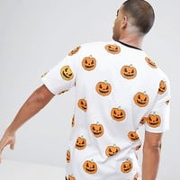 ASOS Halloween Oversized T-Shirt With All Over Pumpkin Print at asos.com