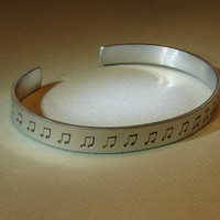 Music note cuff bracelet in aluminum